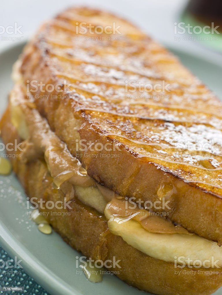 Peanut Butter And Banana Eggy Bread Sandwich With Syrup royalty-free stock photo
