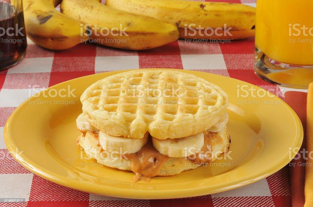 Peanut butter and banana sandwich on a waffle stock photo