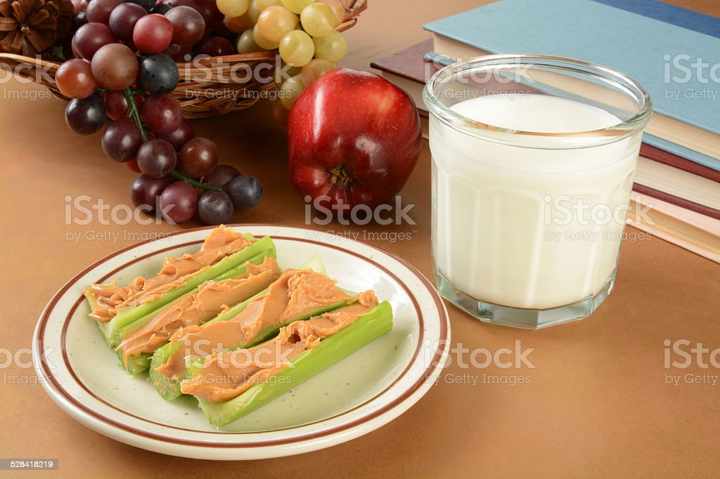 Peanut butter and celery after school stock photo
