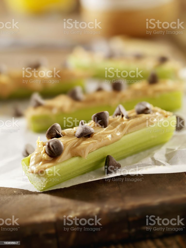 Peanut Butter and Chocolate Chips on Celery stock photo