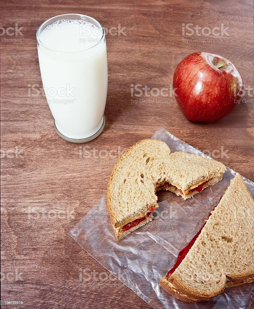 Peanut Butter and jelly sandwich with milk royalty-free stock photo