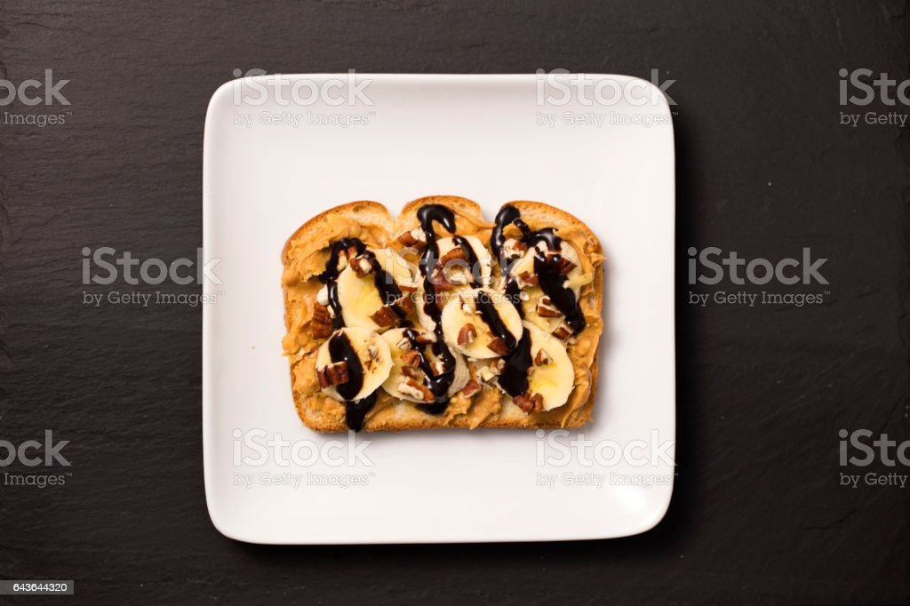 Peanut Butter, Bananas And Nuts Sandwich stock photo