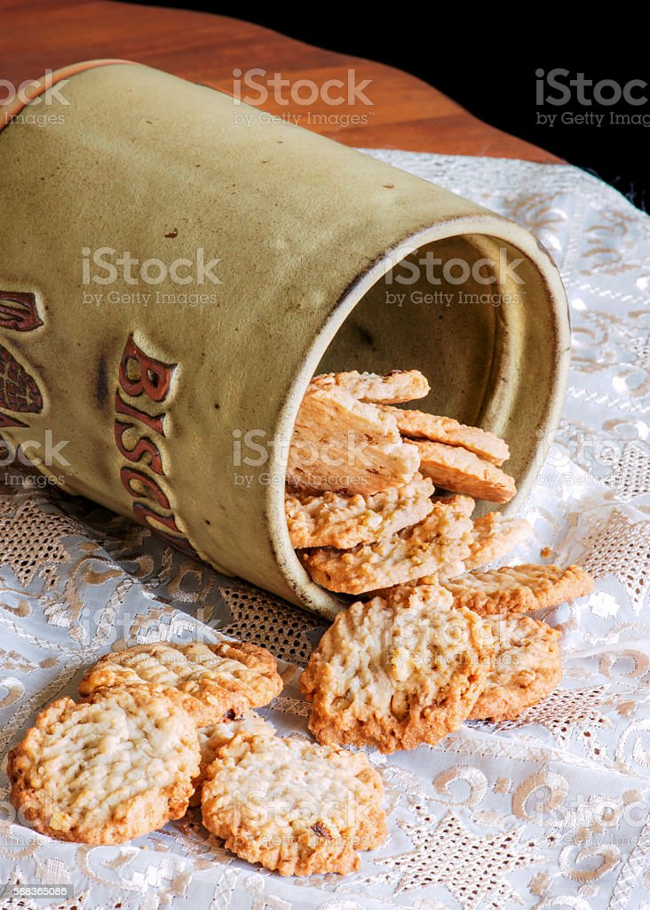 Peanut butter cookies in antique English cookie jar. stock photo