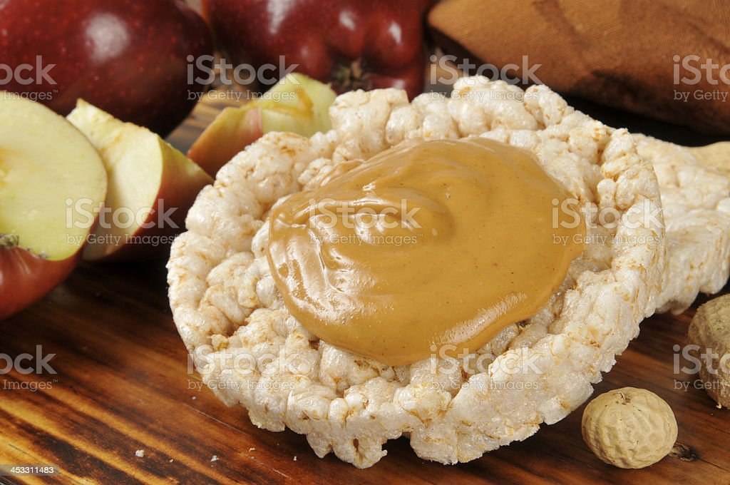 Peanut butter on a rice cake stock photo
