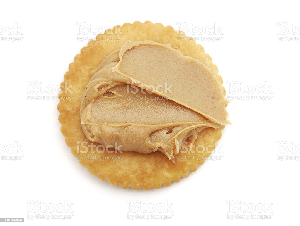 Peanut butter on a round cracker stock photo