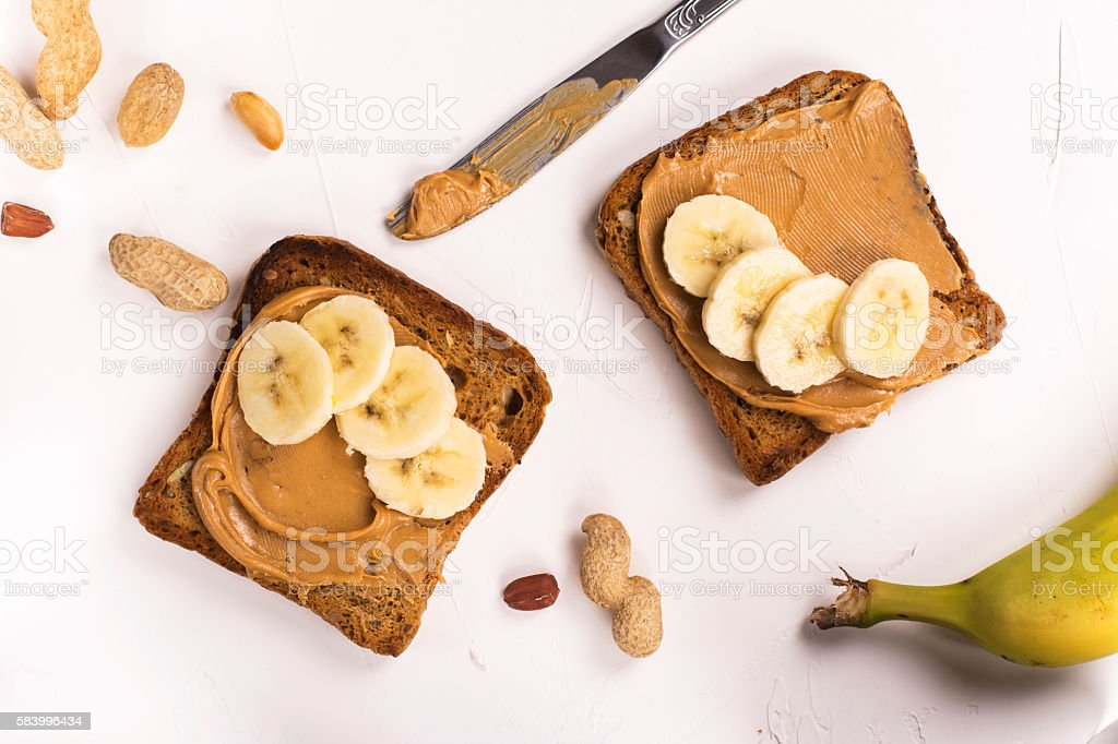 Peanut butter sandwiches on white kitchen table stock photo