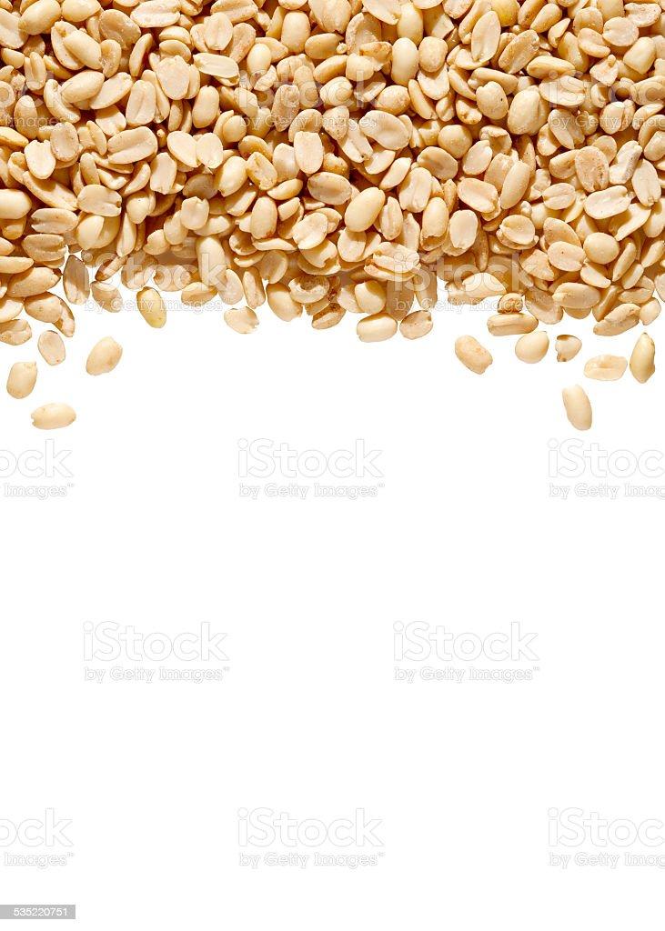 Peanut Pieces Bird Seed on White Background. stock photo