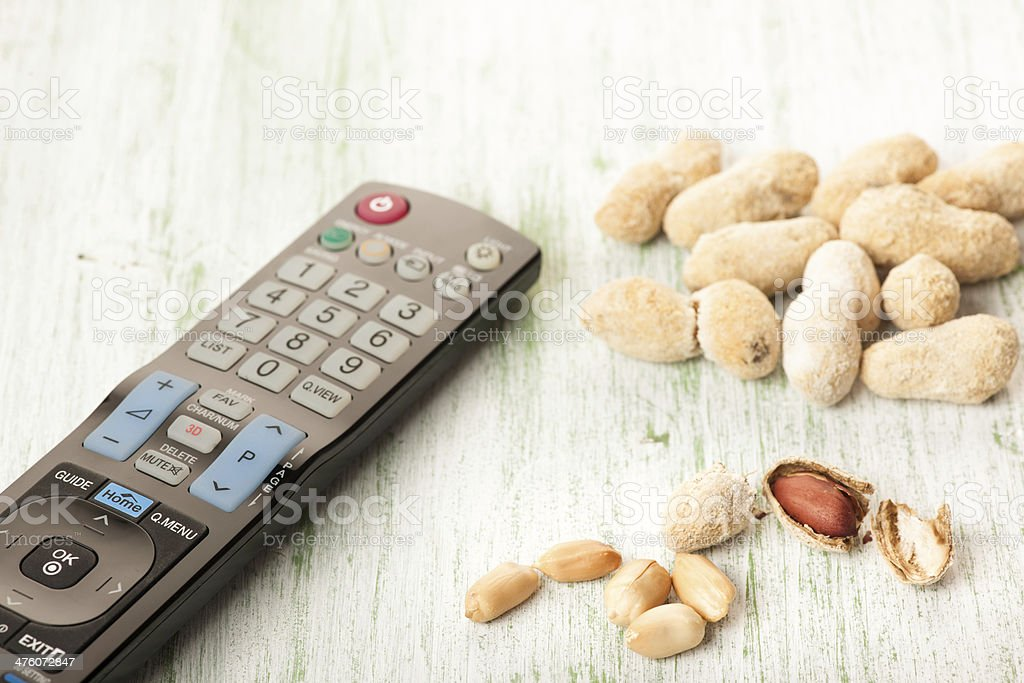 Peanuts and Television Remote Control royalty-free stock photo