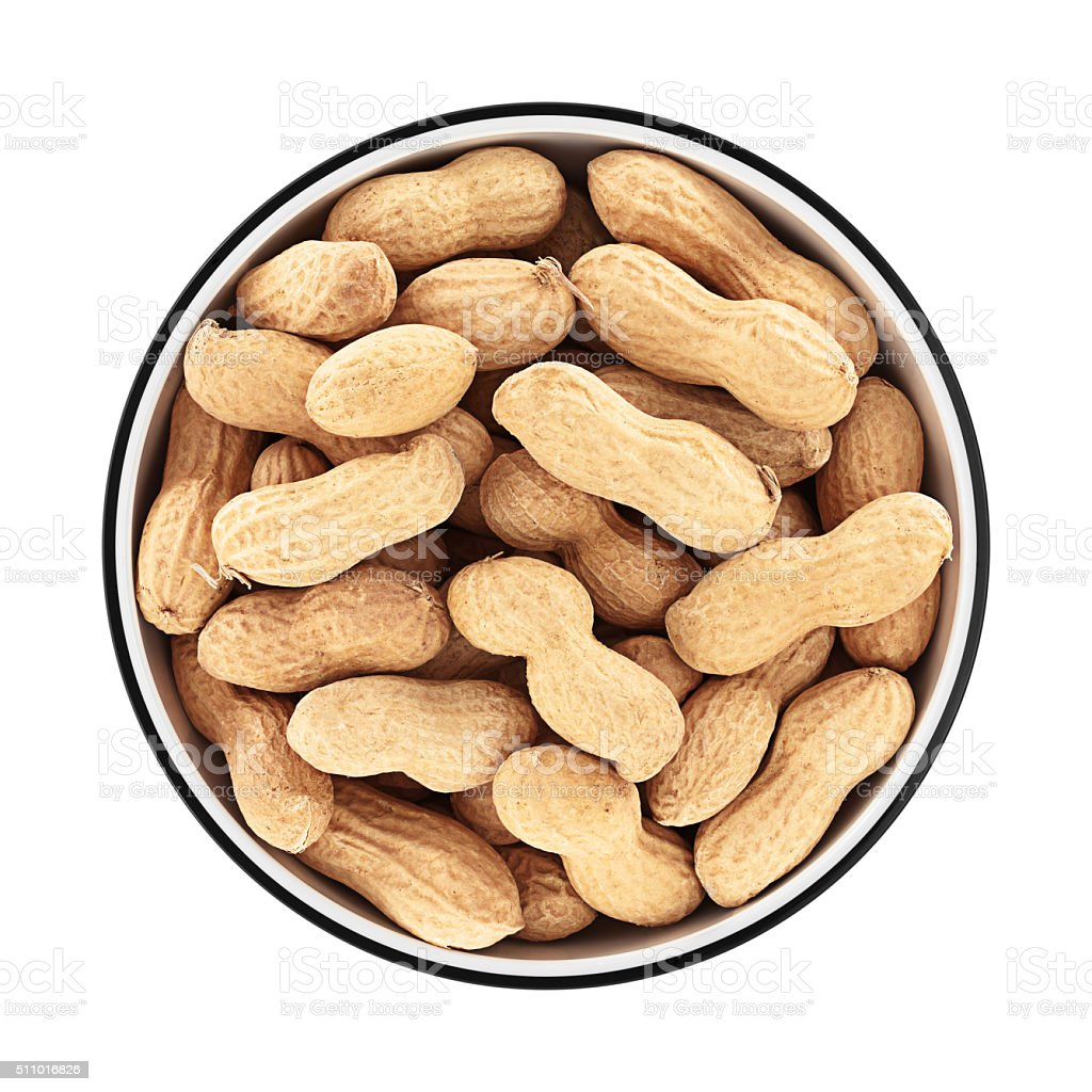 Peanuts in a bowl from directly above stock photo
