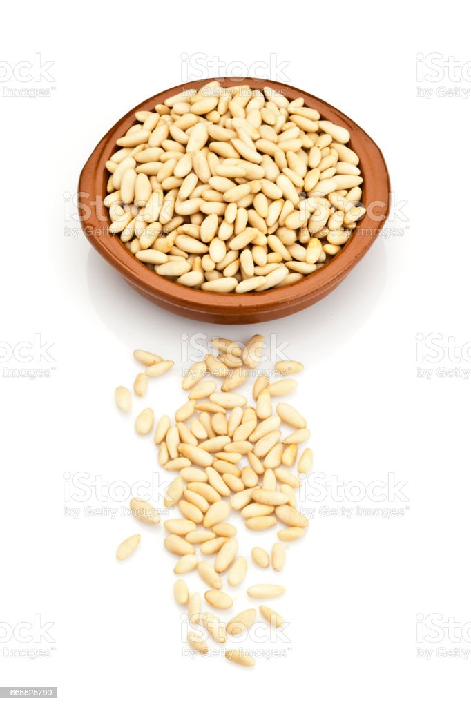 Peanuts in a brown bowl stock photo