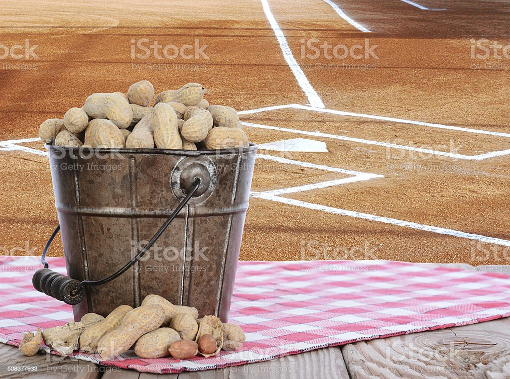 Peanuts in a Pail With Baseball Field Background royalty-free stock photo