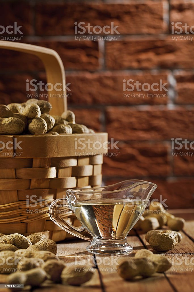 peanuts in basket and on the table royalty-free stock photo