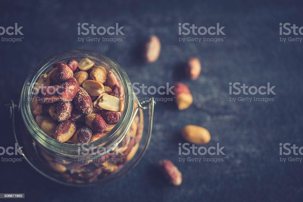 Peanuts in the jar stock photo