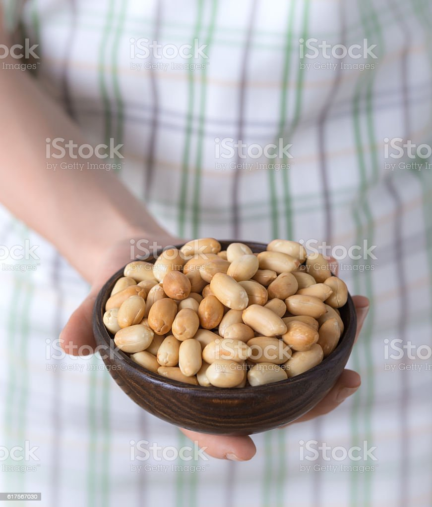 Peanuts in woman hands stock photo