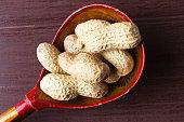 Peanuts on ethnic vintage wooden spoon.