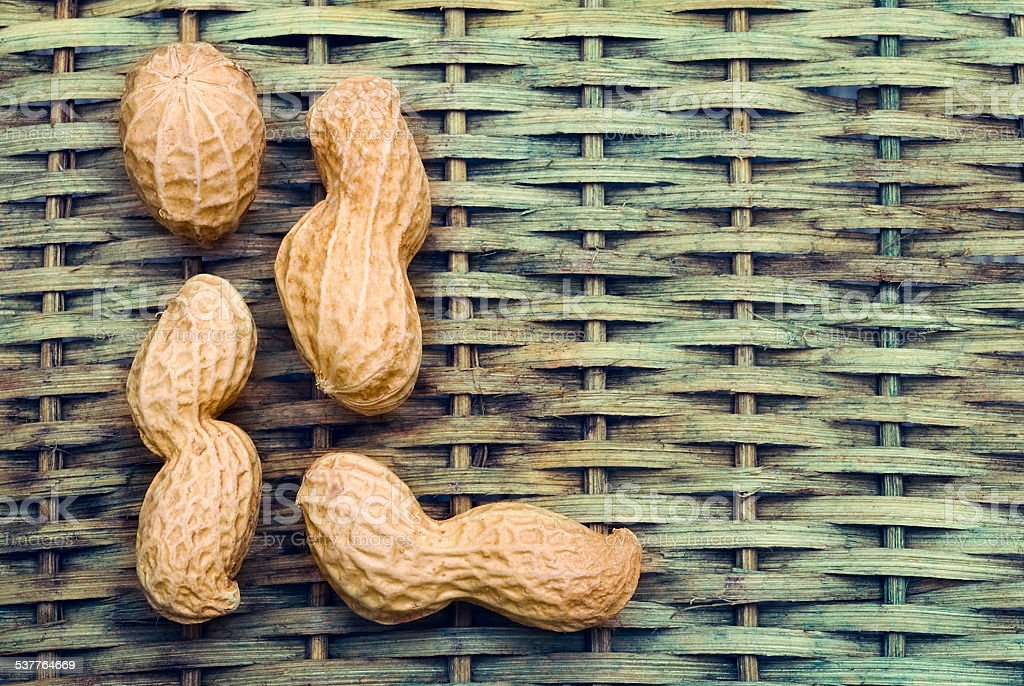 Peanuts with braided background to create a title stock photo