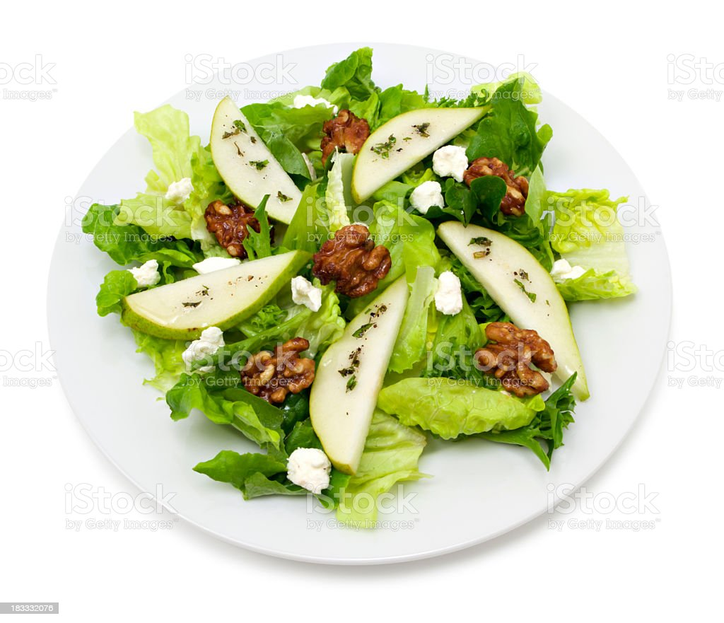 Pear and walnut salad plate royalty-free stock photo