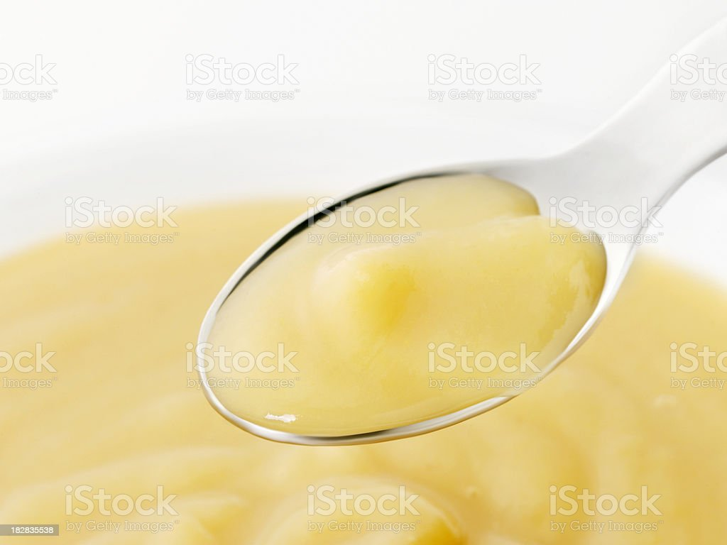 Pear Baby Food on a Spoon royalty-free stock photo