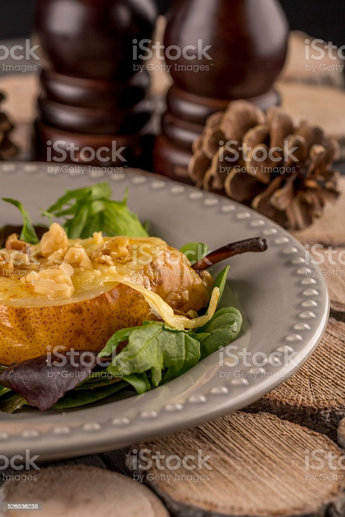 Pear baked with Migneron cheese stock photo