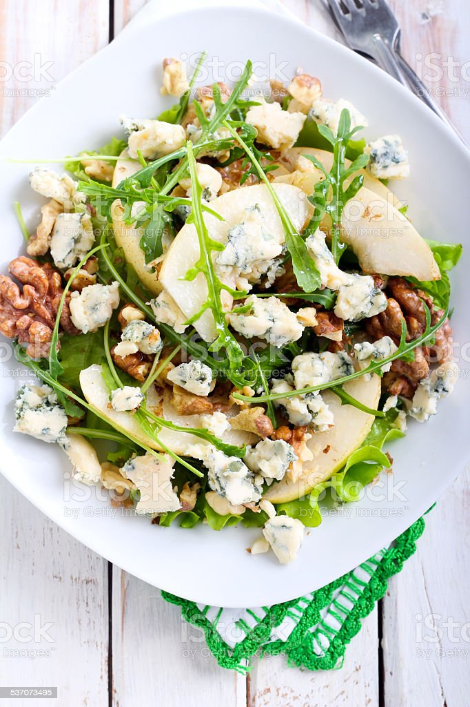 Pear, blue cheese and nut salad stock photo