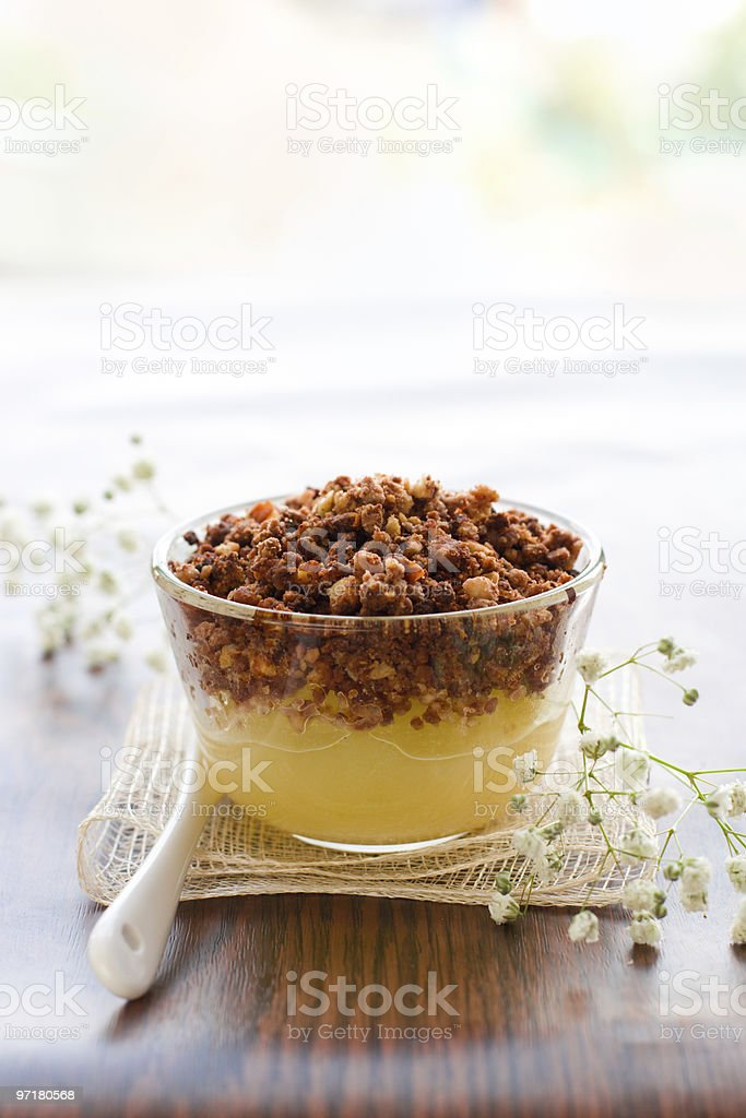 pear crumble with chocolate and almonds stock photo