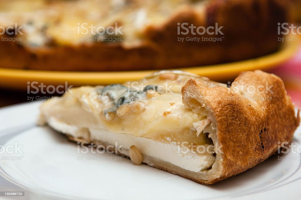 Pear, gorgonzola and brie cheese pie royalty-free stock photo