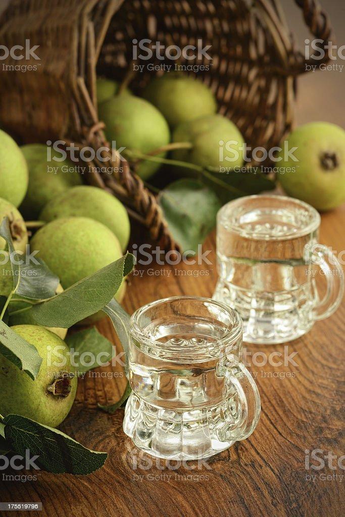 pear liquor in two short glasses stock photo