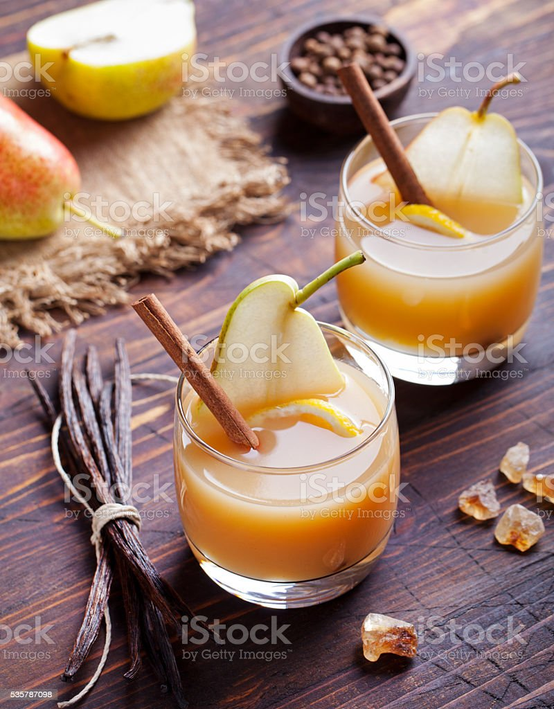 Pear mulled cider with vanilla and cinnamon sticks stock photo