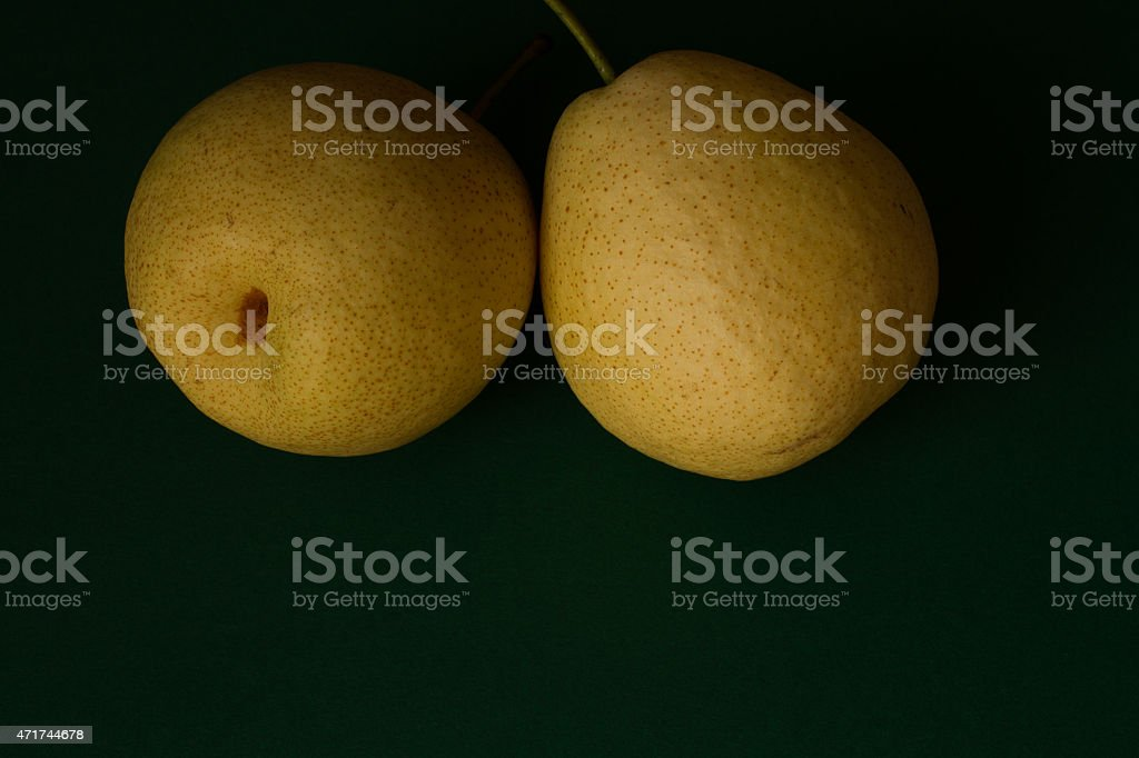 pear on a green background. paradise for diet stock photo
