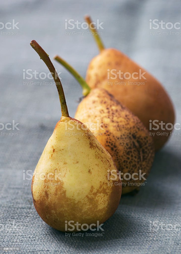 pear on a napkin in a row stock photo