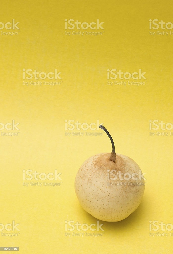 Pear on yellow royalty-free stock photo