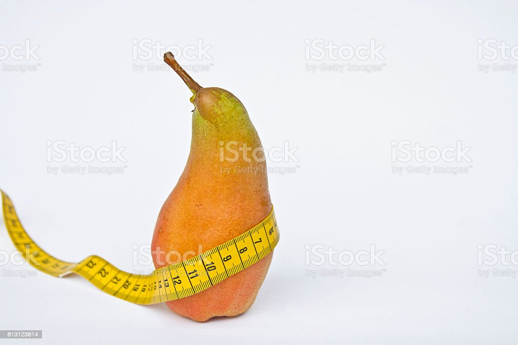 Pear with tape measure stock photo