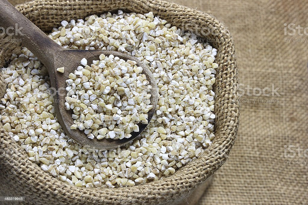 Pearl barley in canvas sack stock photo