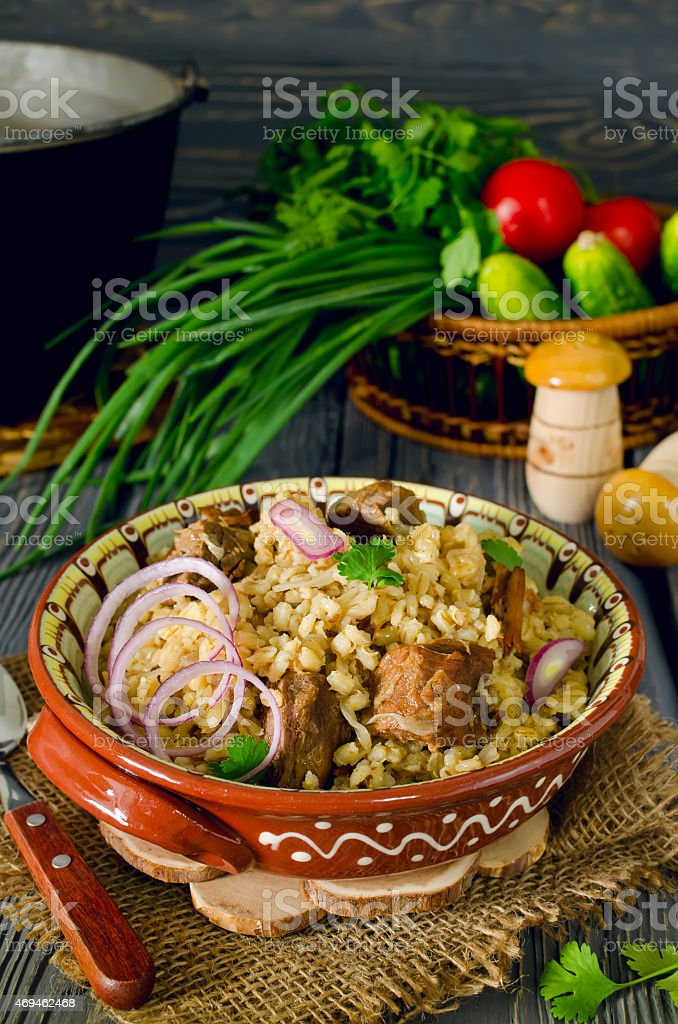 Pearl barley with meat stock photo