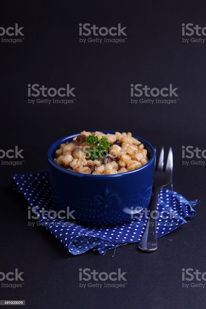 pearl barley with mushrooms stock photo