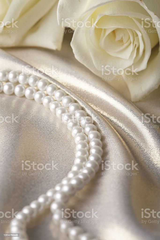 Pearl beads and cream rose stock photo