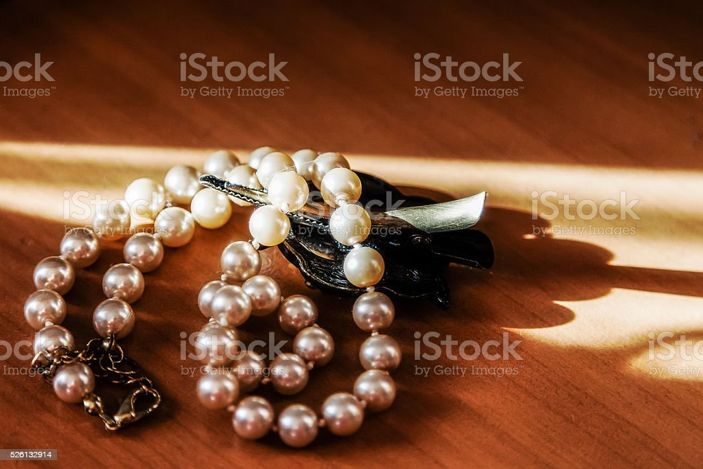 Pearl beads lying on the table and photographed close stock photo