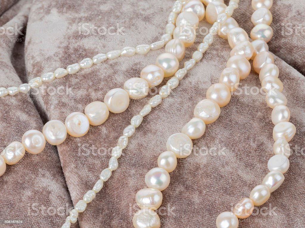 pearl beads on a velvet cloth stock photo