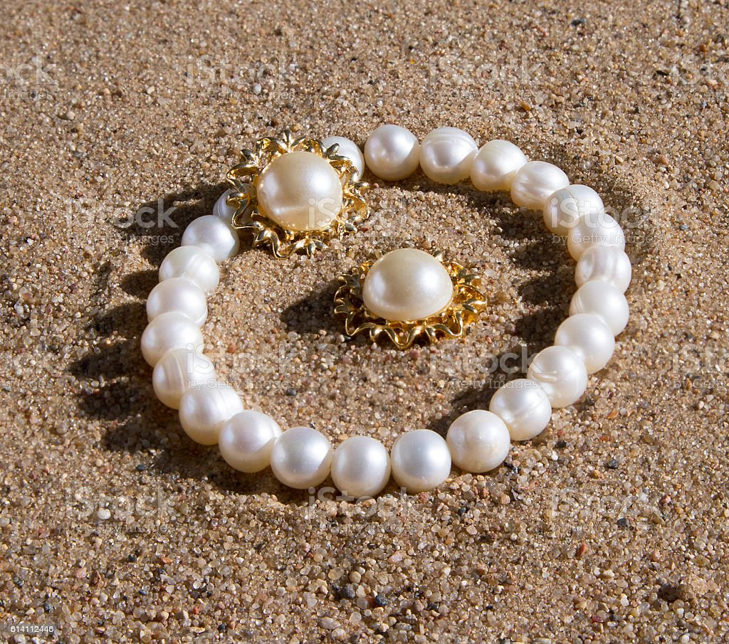 pearl bracelet and earrings lying stock photo