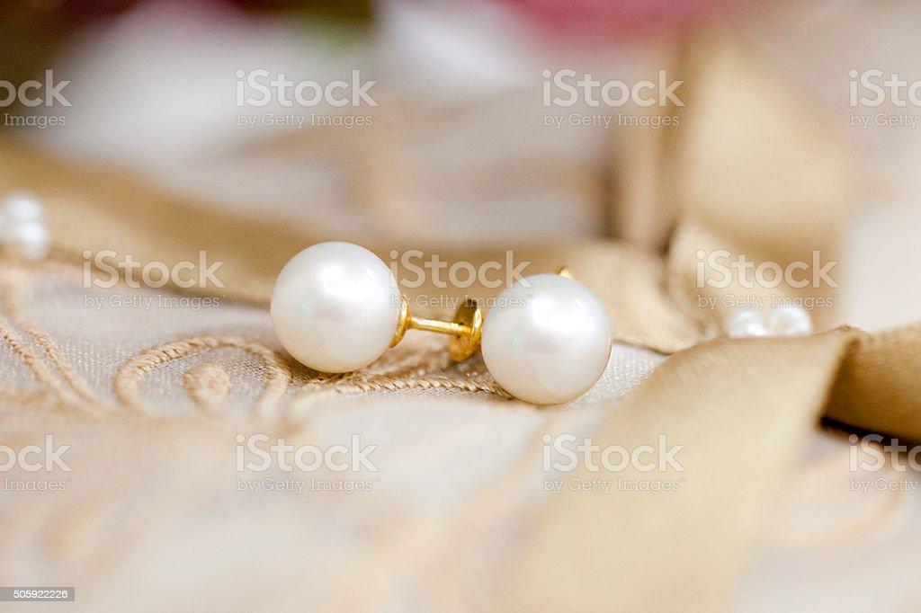 Pearl earring stock photo