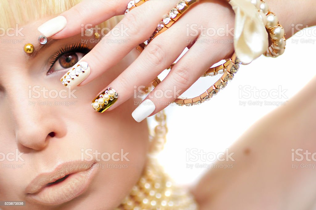 Pearl manicure and makeup. stock photo
