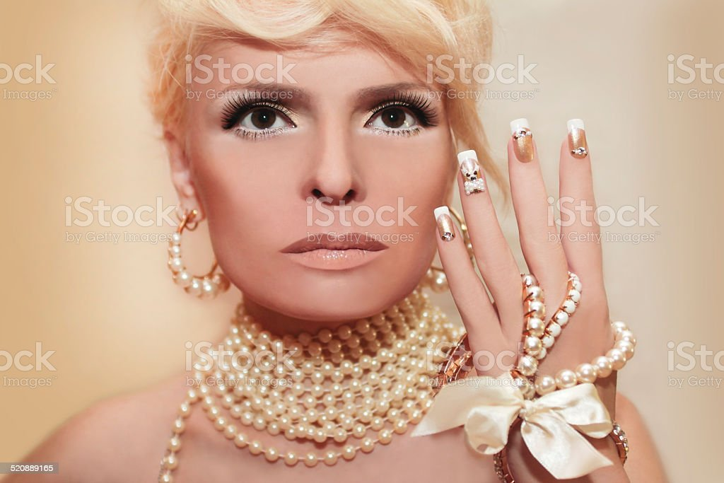 Pearl nails and makeup. stock photo