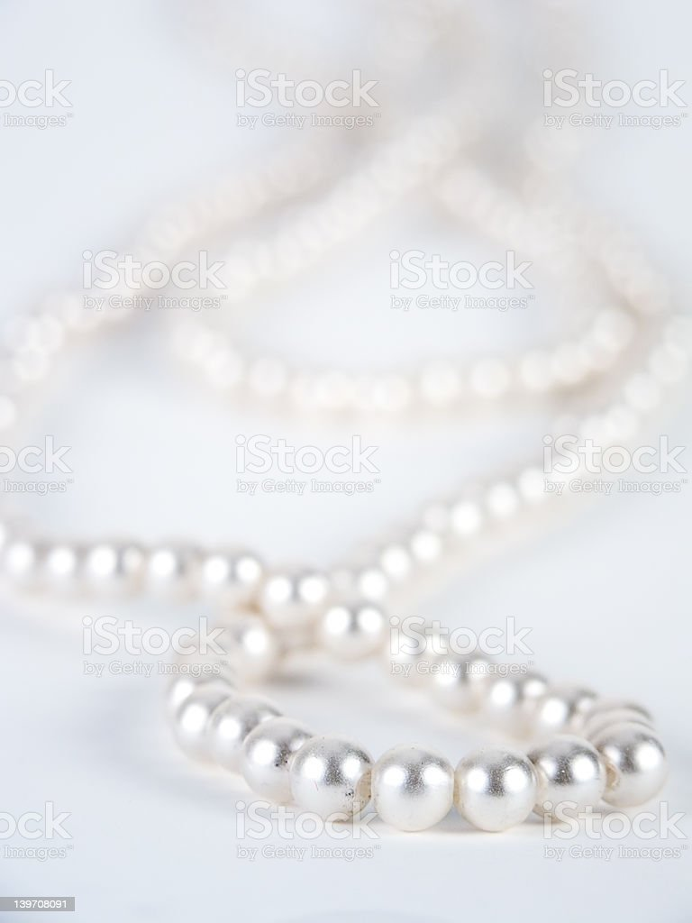 Pearl necklace against white background royalty-free stock photo