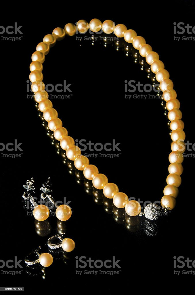 pearl necklace and earrings stock photo