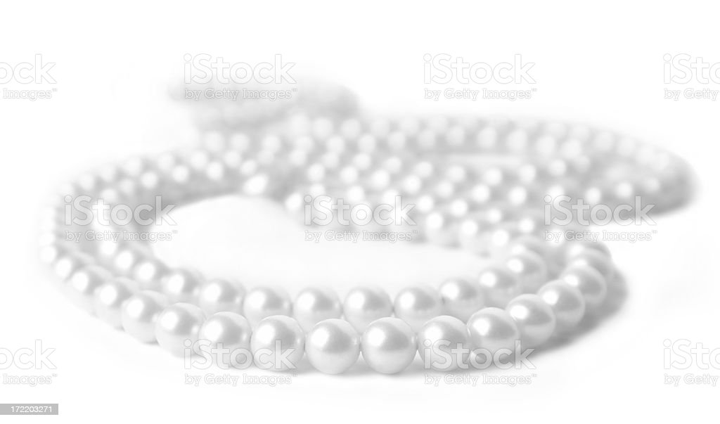 Pearl Necklace Lying on a White Background royalty-free stock photo