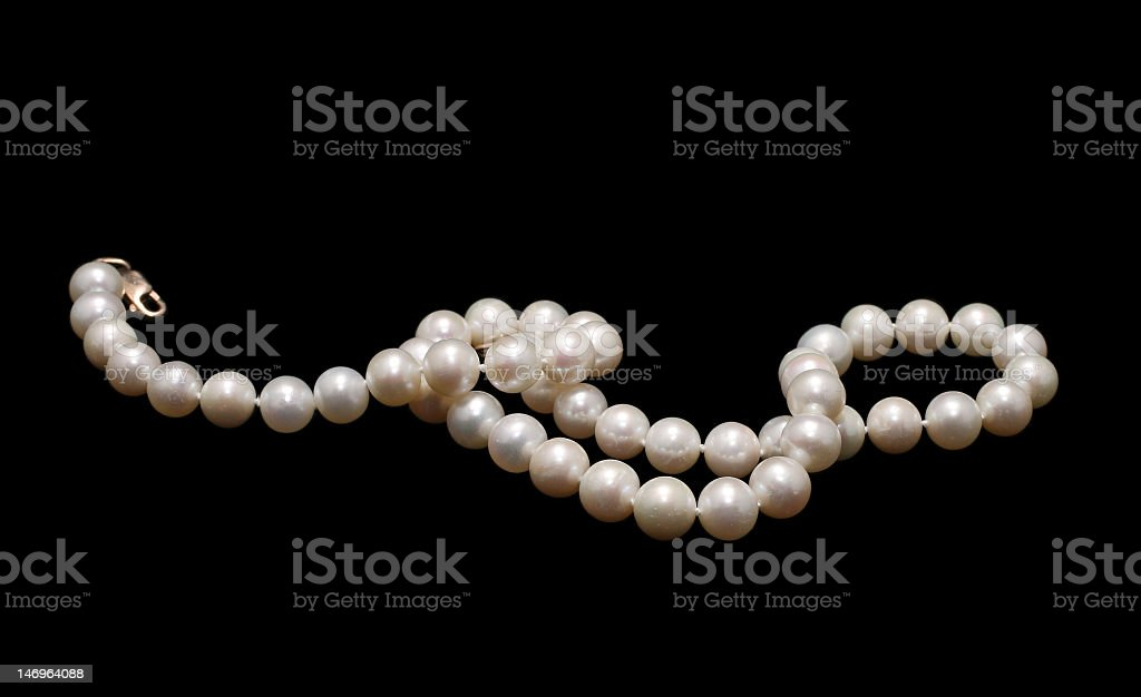 Pearl necklace on a black background stock photo