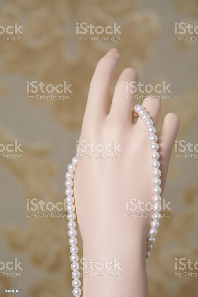 Pearl necklace on a mannequins hand royalty-free stock photo