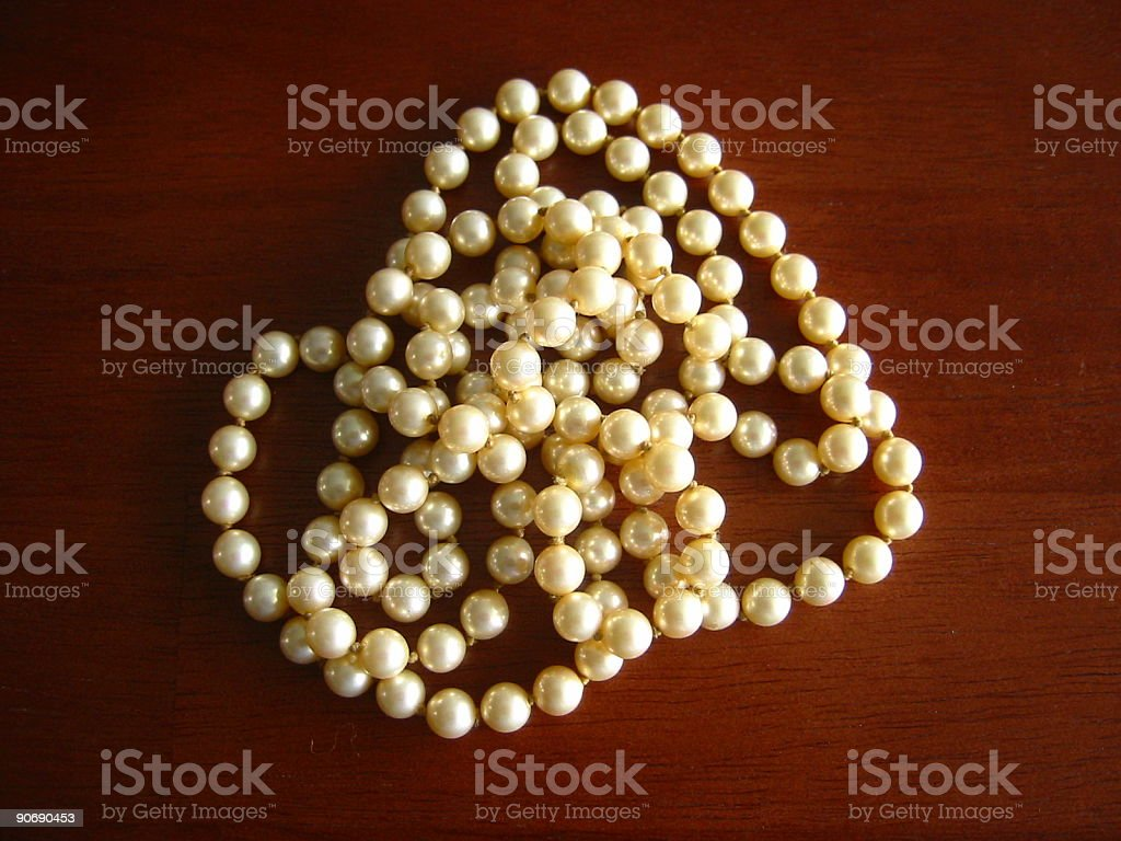 pearl necklace on a table royalty-free stock photo