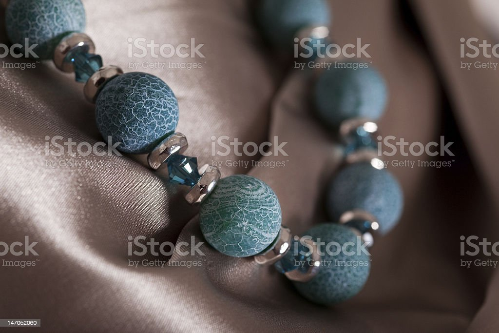 Pearl necklace on glossy satin royalty-free stock photo