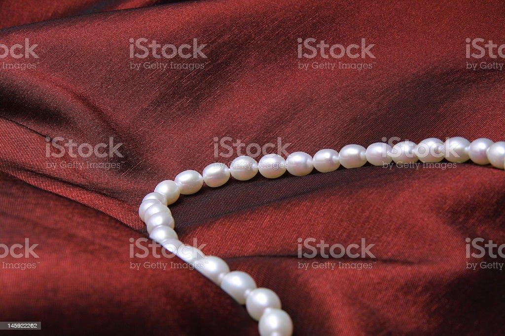 Pearl On Satin royalty-free stock photo